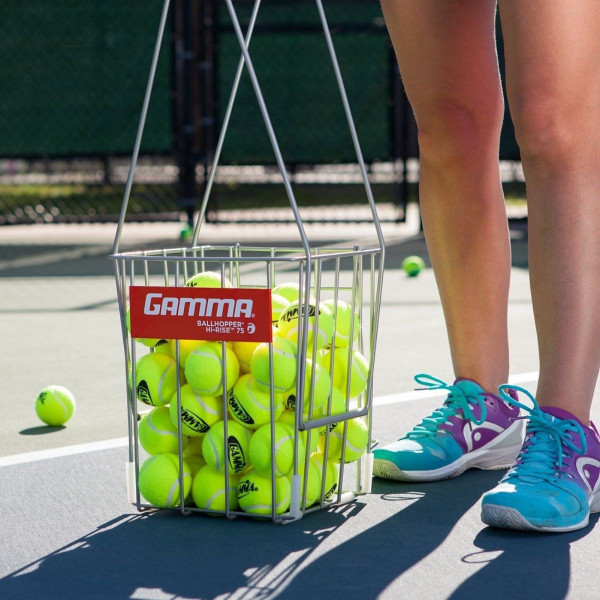 Ball Hopper Hi-Rise 75 featured on a tennis court filled with tennis balls.