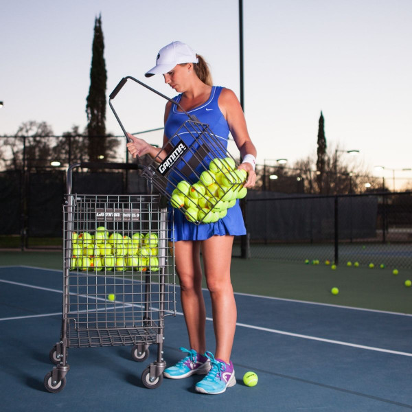 Girl pouring tennis balls out of the Ball Hopper Pro 90 into a Brute 325 Teaching Cart.