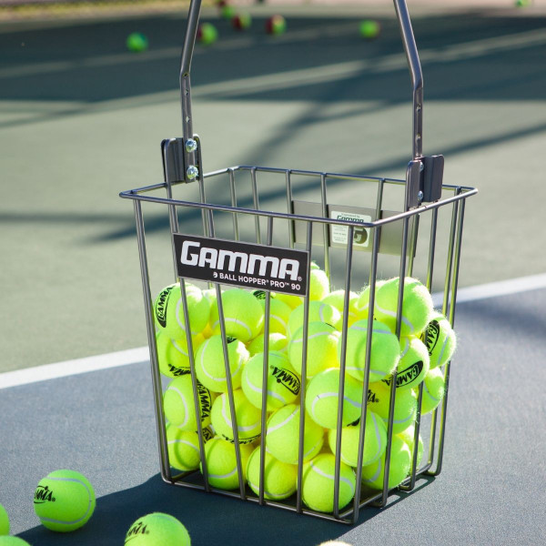 The Ball Hopper Pro 90 on a tennis court filled with tennis balls.