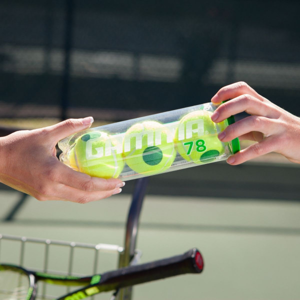 Two Players Exchanging a Clear Can of 3 GAMMA Green Dot Tennis Balls