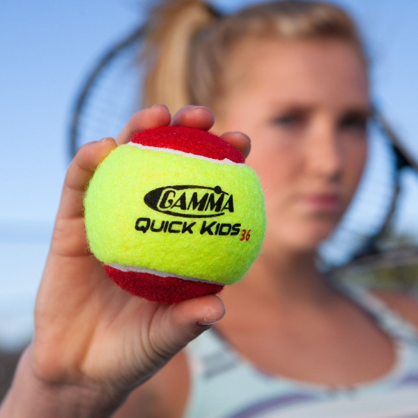 Girl Holding Out Her Hand Towards Camera Showing Off the GAMMA Quick Kids 36 Ball