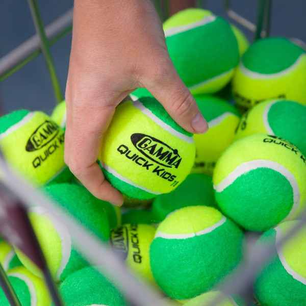 Person's Hand Grabbing A Quick Kids 78 Tennis Ball Out Of A Basket Full of GAMMA Quick Kids 78 Tennis Balls