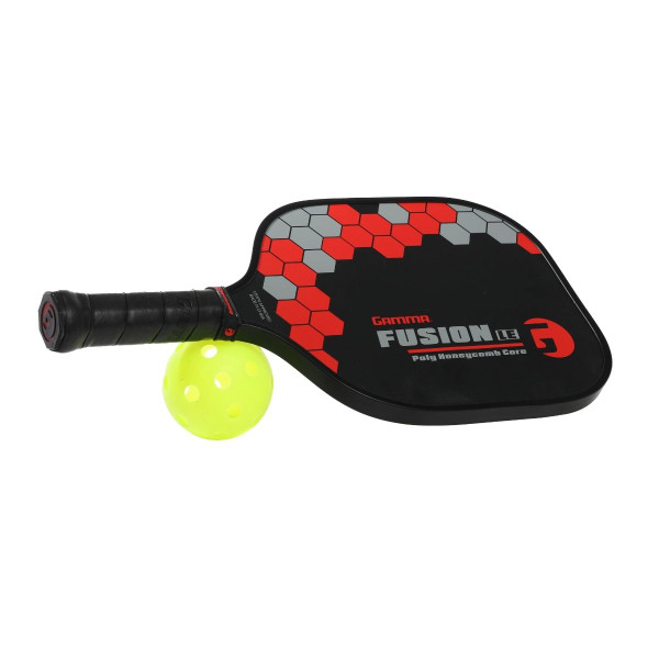 Red GAMMA Fusion LE Pickleball Paddle propped up on a pickleball ball.