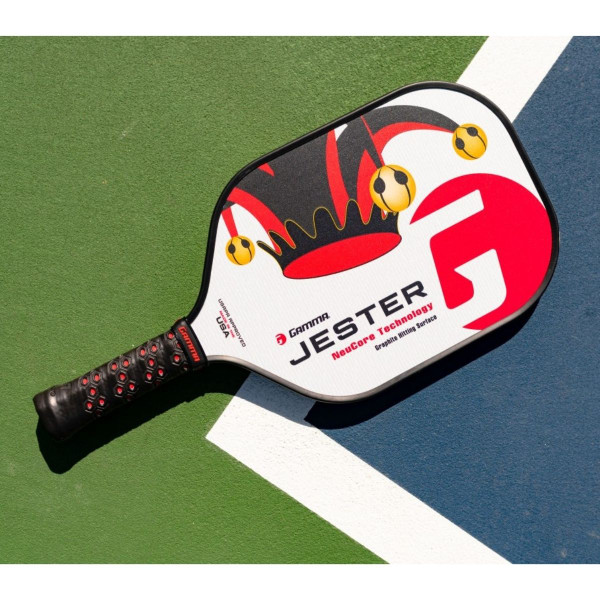 Red Jester Pickleball Paddle lying on a pickleball court