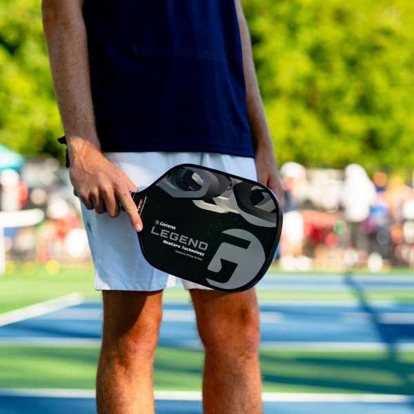 Pickleball Player holding a Black GAMMA Legend NeuCore Pickleball Paddle