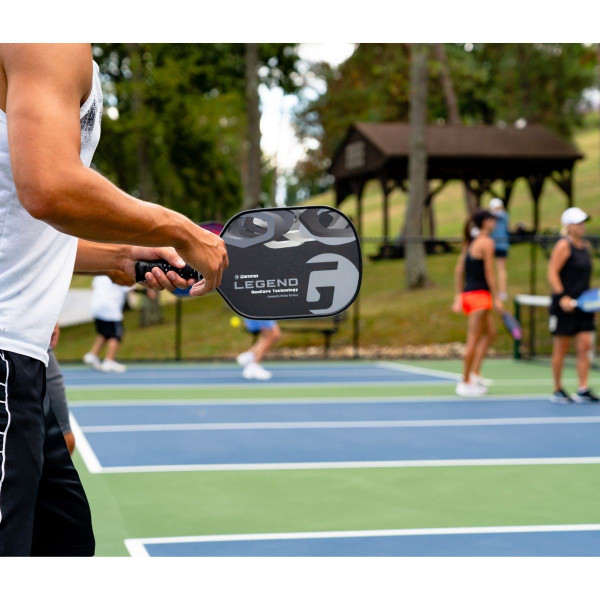 Pickleball Player Playing with a Black GAMMA Legend NeuCore Pickleball Paddle