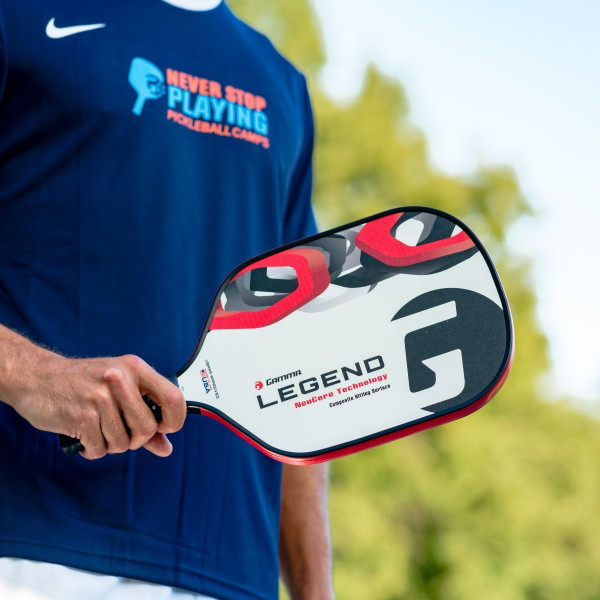 Pickleball player holding a White GAMMA Legend NeuCore Pickleball Paddle