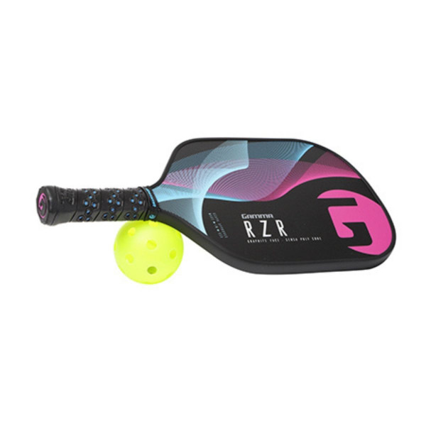 Pink RZR Pickleball Paddle with its handle propped up on a pickleball ball