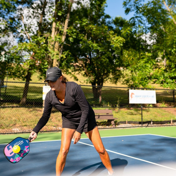 Pickleball player hitting a return ball with the Pink GAMMA Shard NeuCore Pickleball Paddle