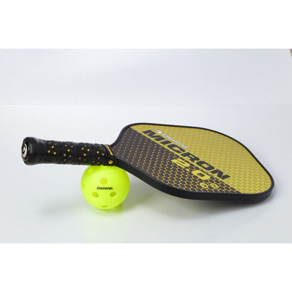 Yellow & Black GAMMA Micron 2.0 Pickleball Paddle propped up on a pickleball.