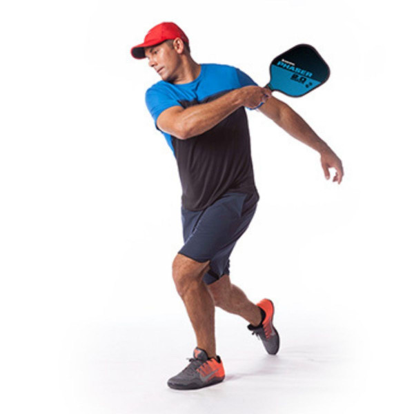 Player following through his swing with the Blue and Black GAMMA Phaser 2.0 Pickleball Paddle