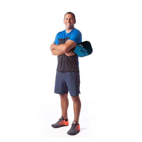 Pickleball player smiling for the camera and holding a Blue and Black GAMMA Phaser 2.0 Pickleball Paddle